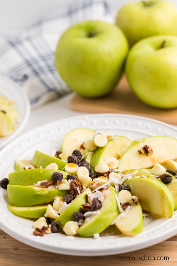 Granny Smith apple slices topped with caramel chocolate, coconut, and more.