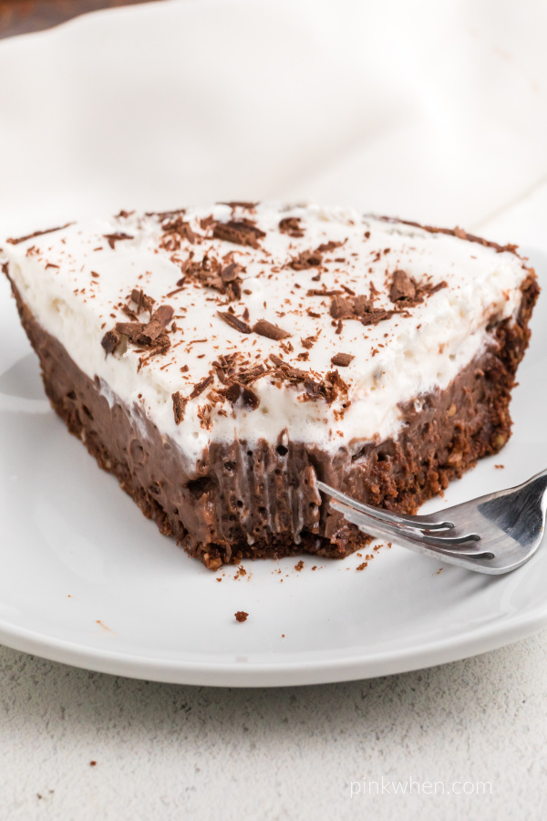 Slice of chocolate cream pie with a slice missing.