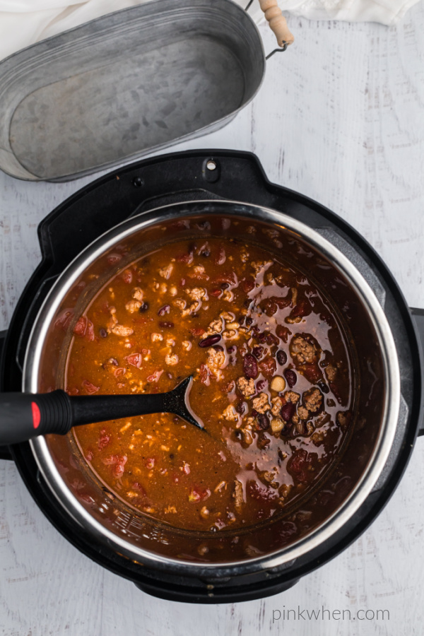 Turkey chili inside of a pressure cooker.