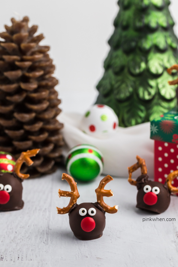 OREO Reindeer truffles arranged around a cute Christmas background.