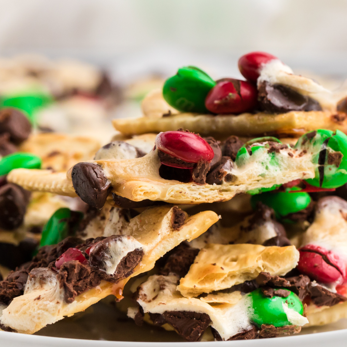 Christmas CRack Saltines piled high on a white plate.