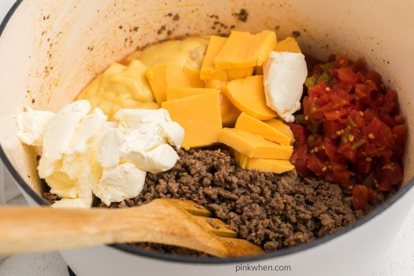 Cheese, soup, and Rotel aded to the taco meat mixture.