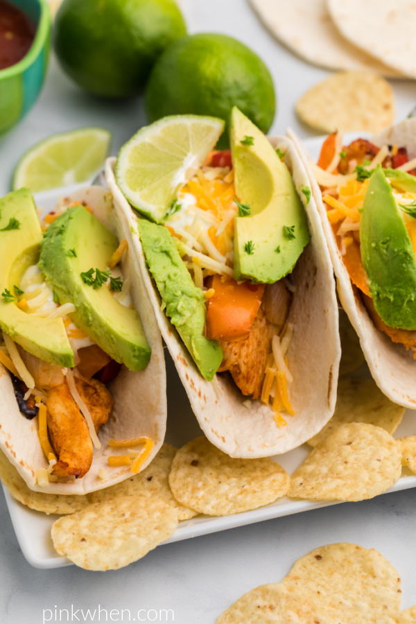 Chicken Fajitas made in the Air Fryer with toppings and surrounded by chips.