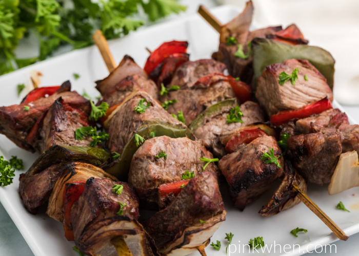 Cooked Air Fryer Steak Kabobs on a white plate and ready to serve.