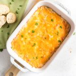 Cheesy Hot Crab Dip in a casserole dish ready to eat.