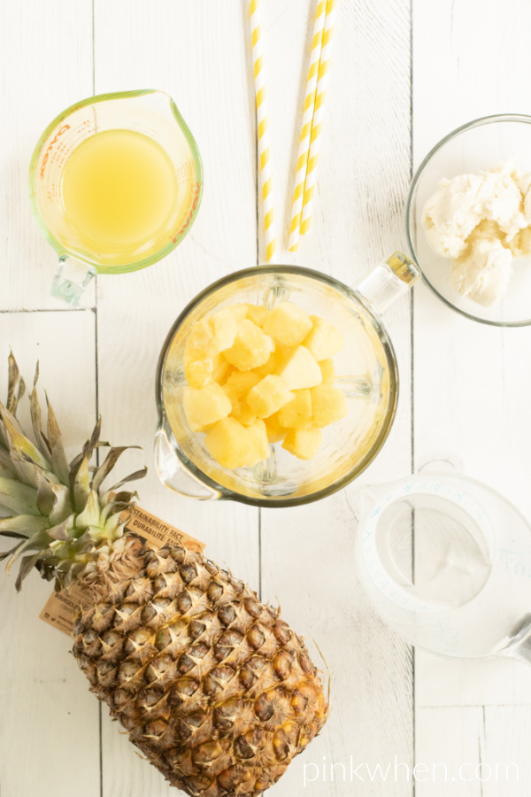 Ingredients needed for Pineapple Dole Whip: pineapple chunks, vanilla ice cream, and pineapple juice.