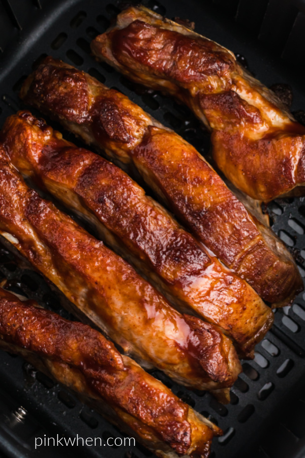 fully cooked air fryer country-style ribs in the basket of the air fryer.