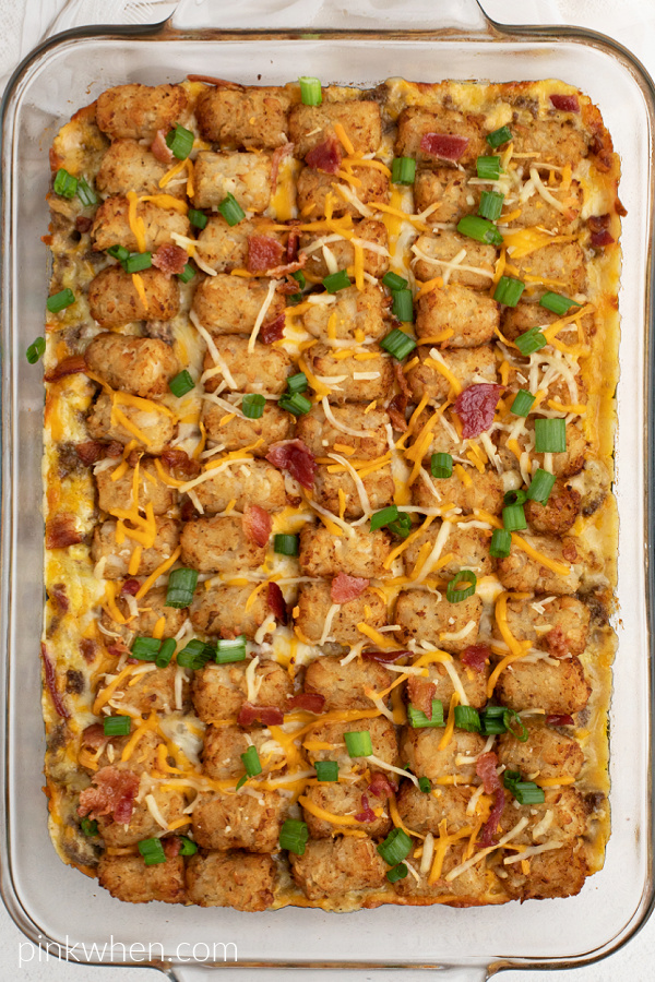 Overhead shot of the bacon cheeseburger tater tot casserole in a dish, ready to serve.