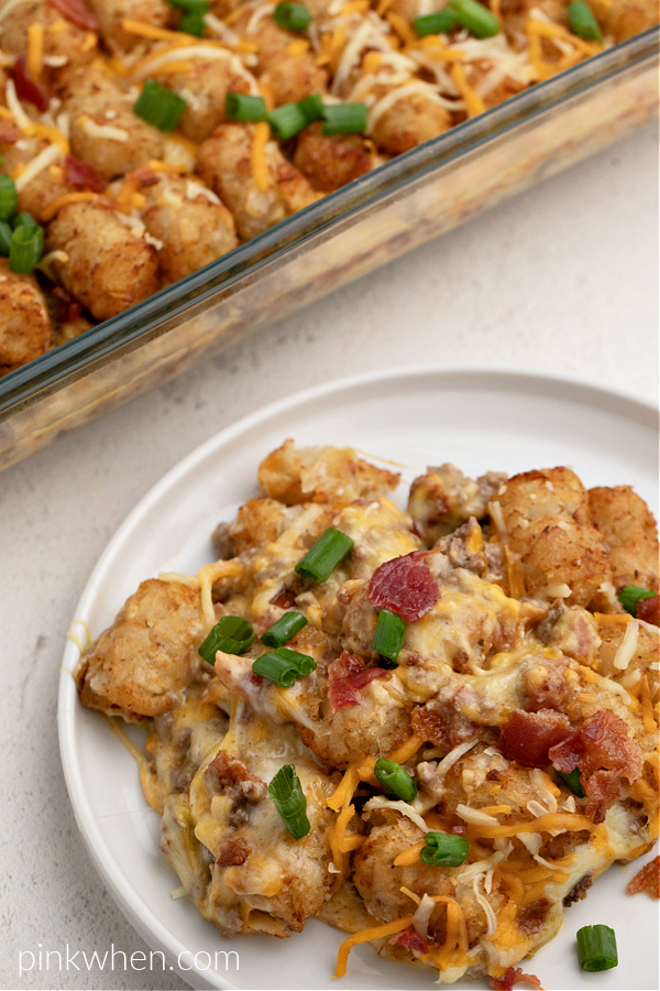 Bacon Cheeseburger Tater Tot Casserole on a plate ready to serve.