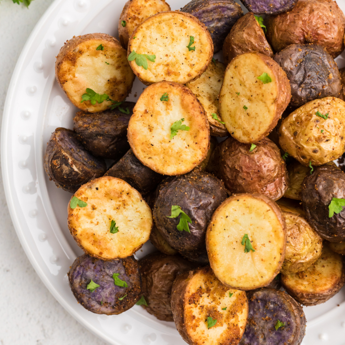 air fryer roasted potatoes seasoned and garnished with fresh parsley.