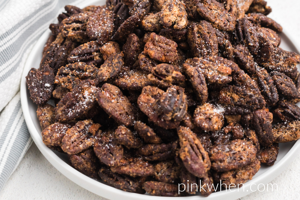 Air Fryer Candied Pecans on a white plate ready to eat.