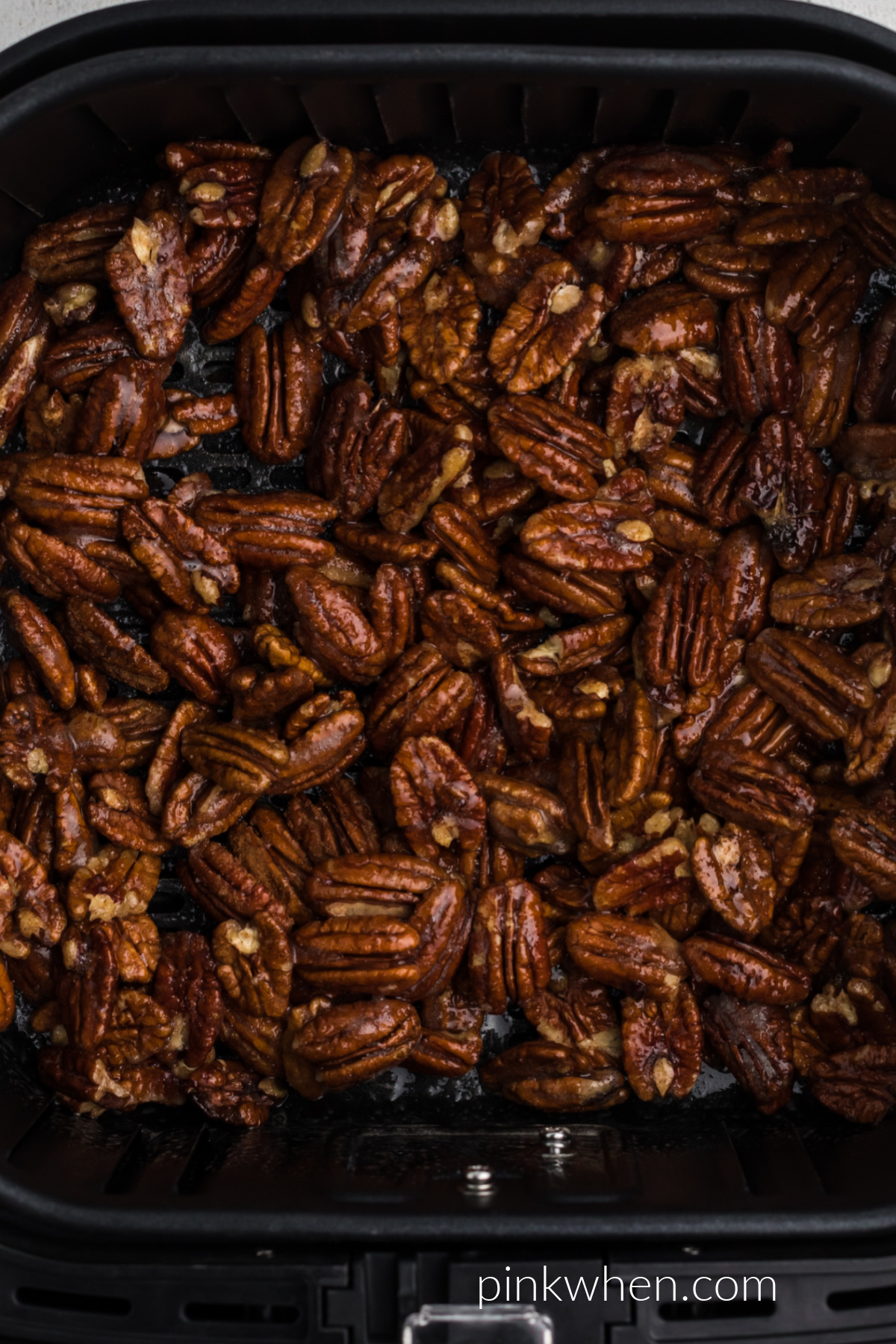 Candied pecans in the air fryer ready to cook.