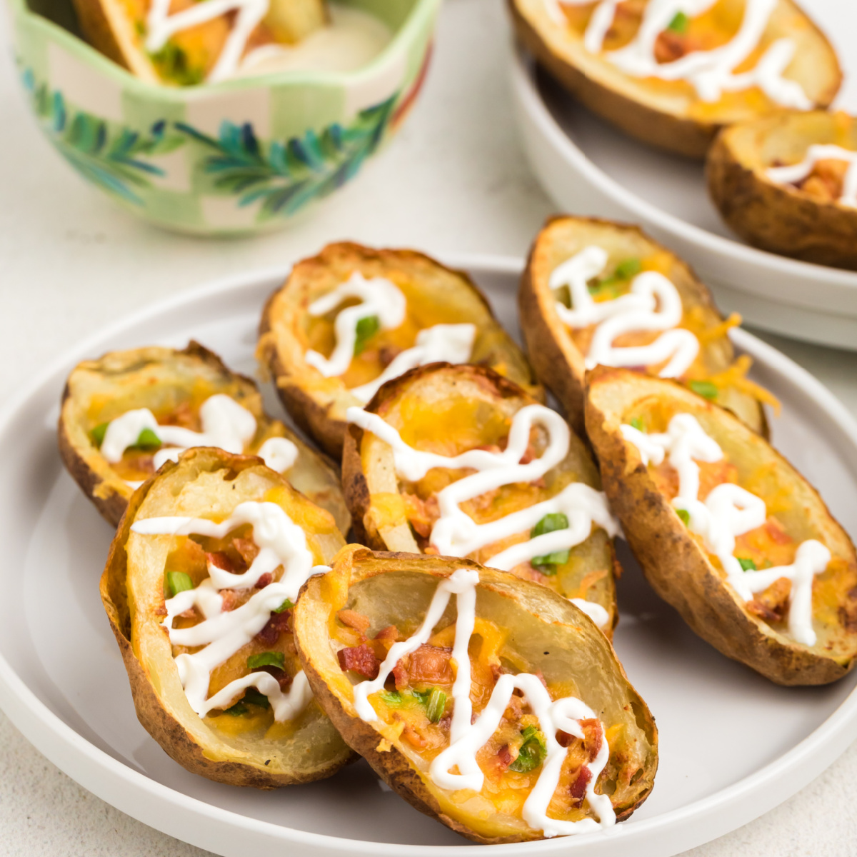 Loaded air fryer potato skins ready to eat.
