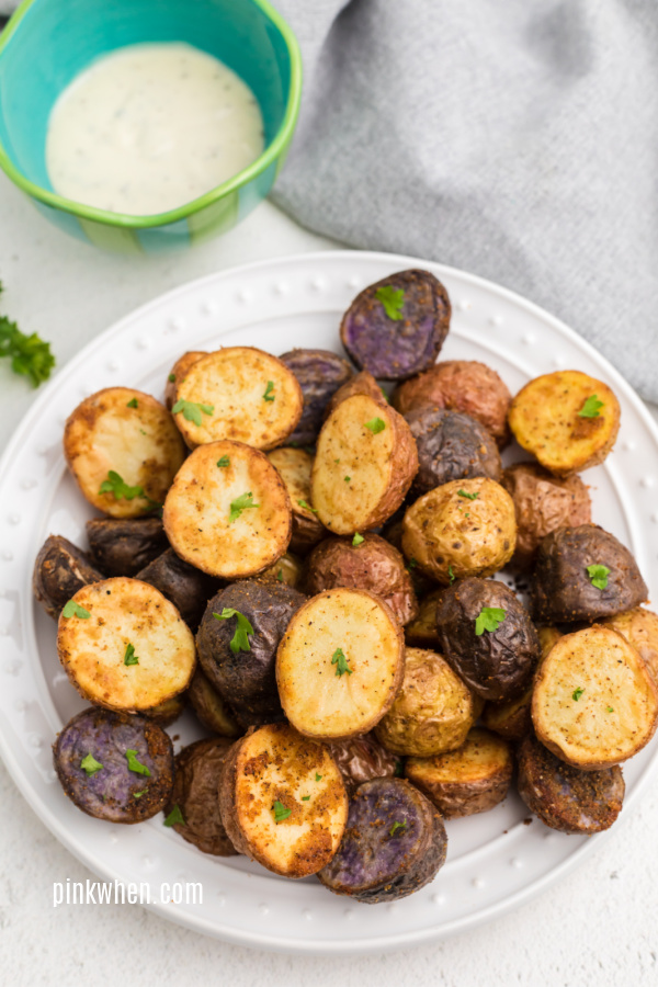Roasted potatoes made in the air fryer on a white plate.