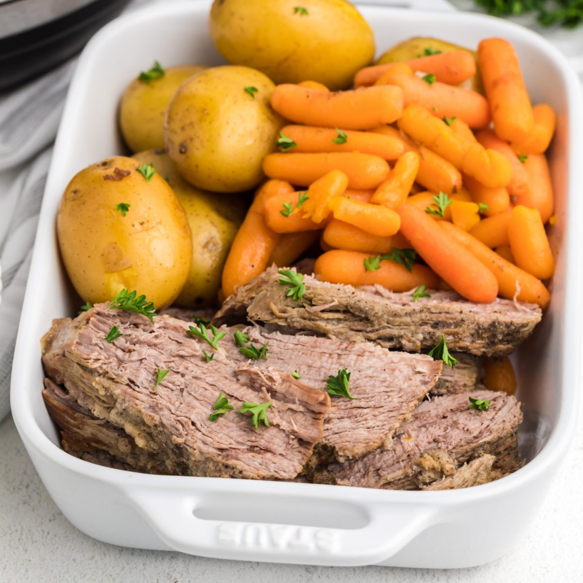 Instant Pot Tri Tip sliced and served with potatoes and carrots.