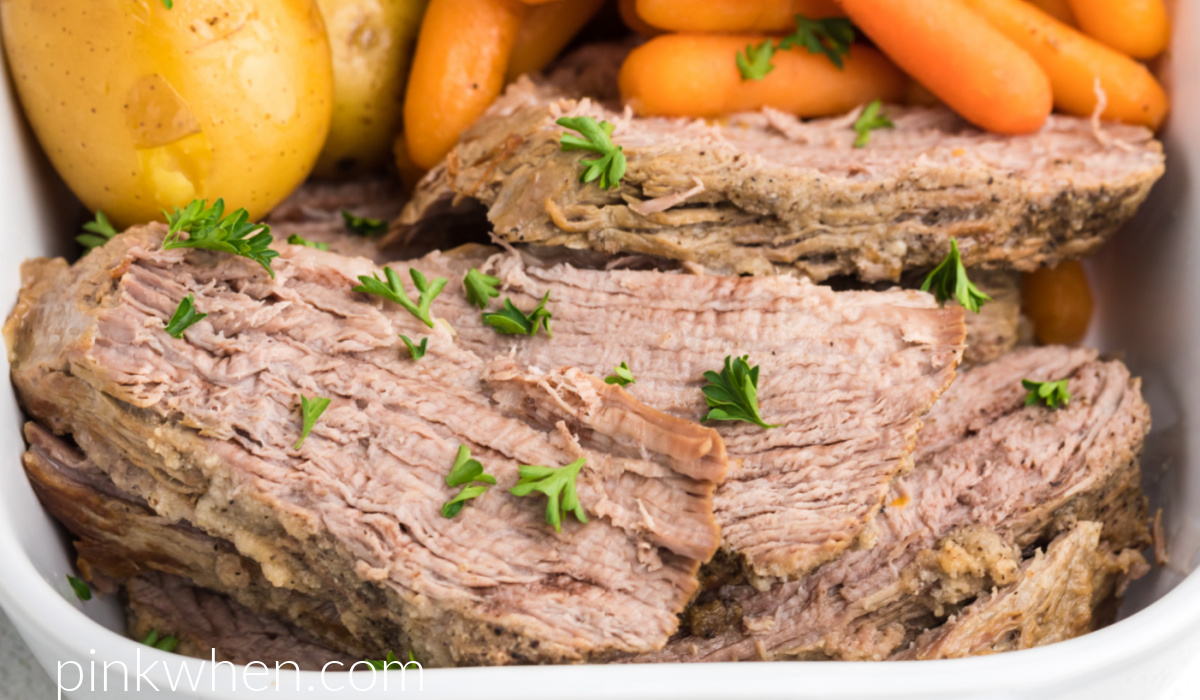 Close up photo of Instant Pot Tri Tip sliced and served with potatoes and carrots and topped with fresh parsley.