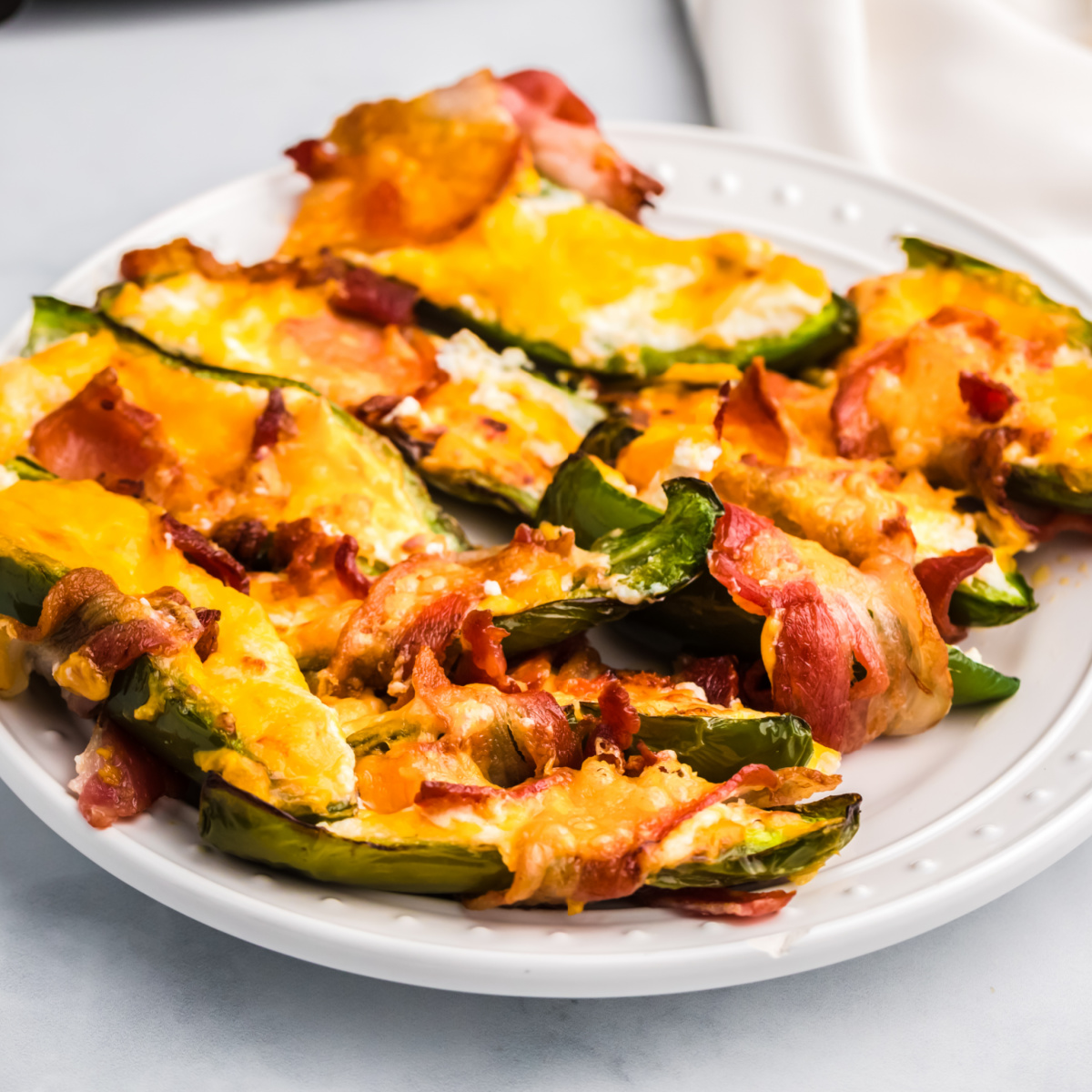 Cooked Jalapeno Poppers on a white plate ready to eat