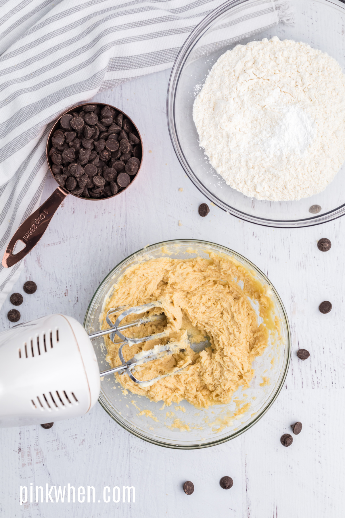 Butter, sugars, egg, and vanilla creamed together in a mixing bowl.