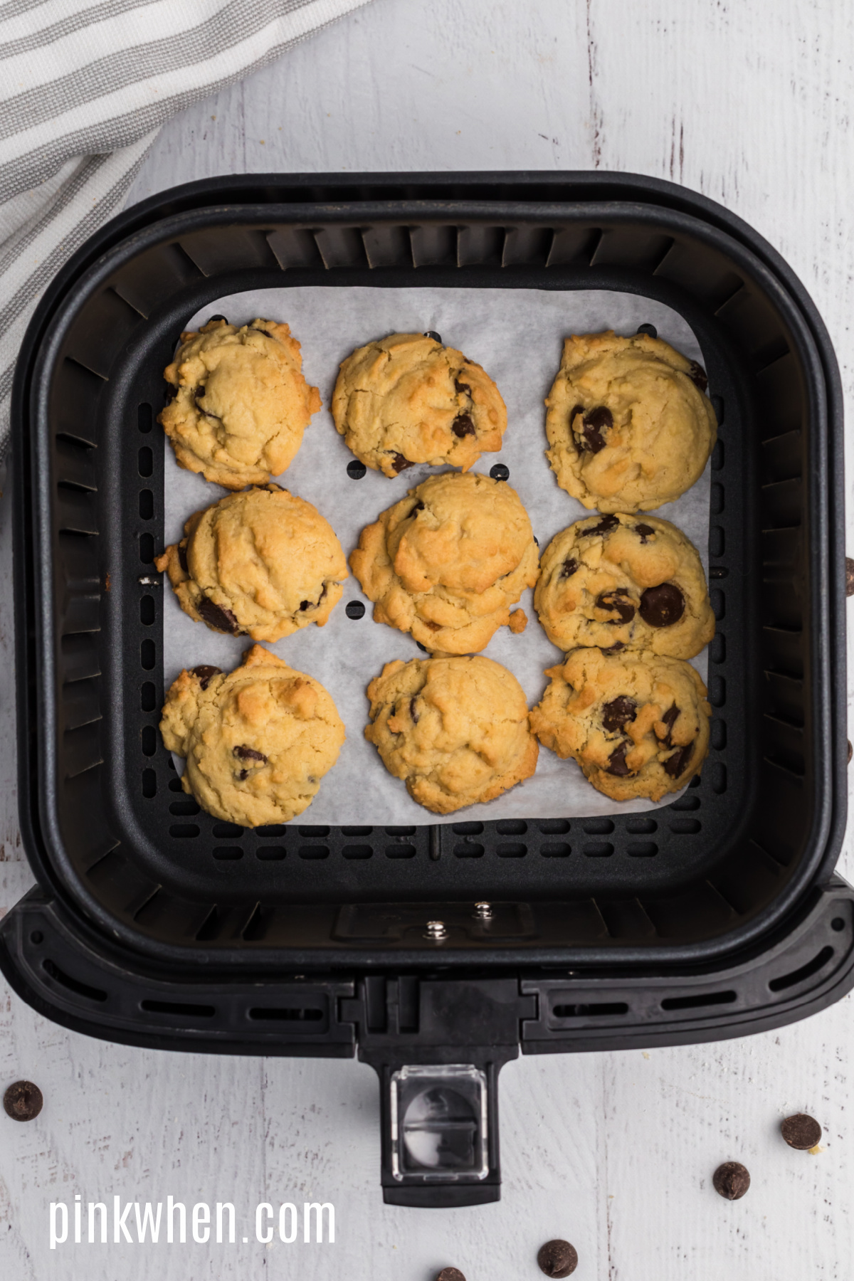 Cookies fully cooked in the basket of the air fryer.
