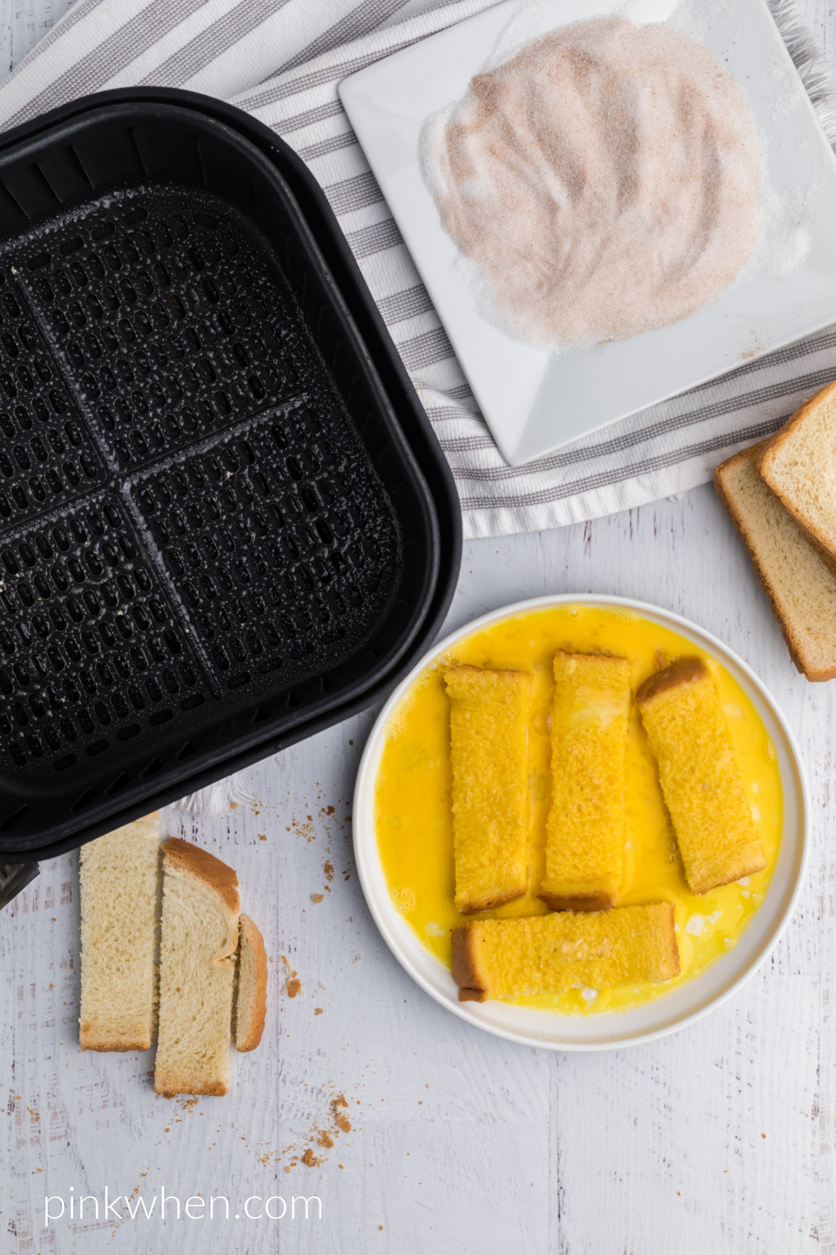 French toast sticks dipped into egg before being added to cinnamon and sugar mixture and placed into the air fryer.