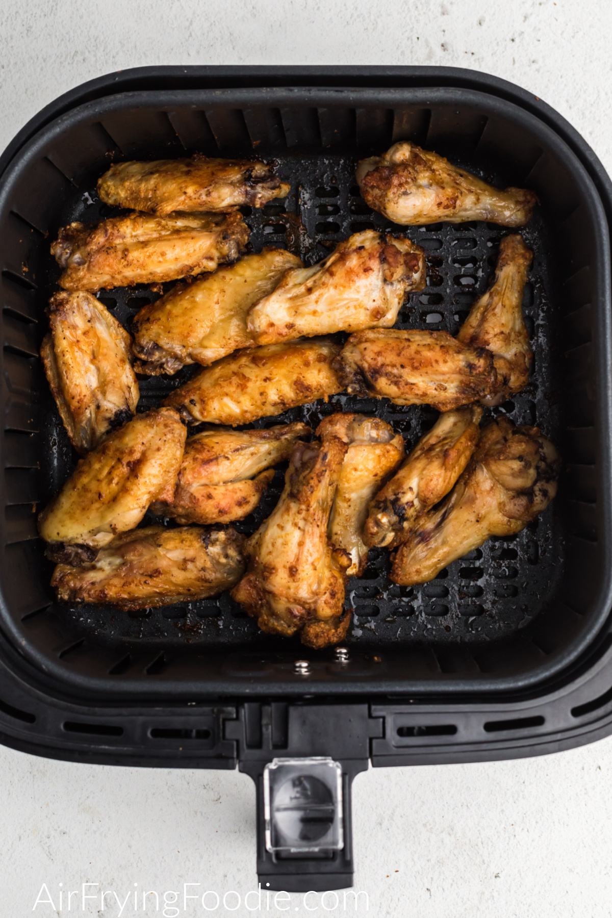 Air Fryer Garlic Parmesan Chicken Wings in the basket of the air fryer.