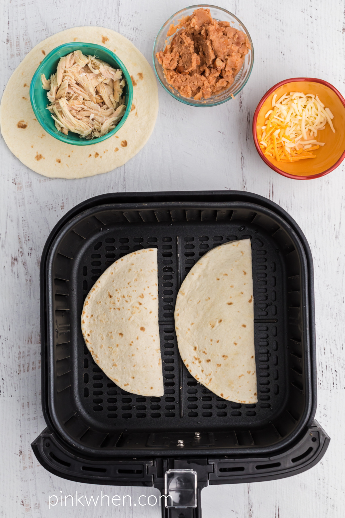 Quessadillas in the basket of the air fryer.