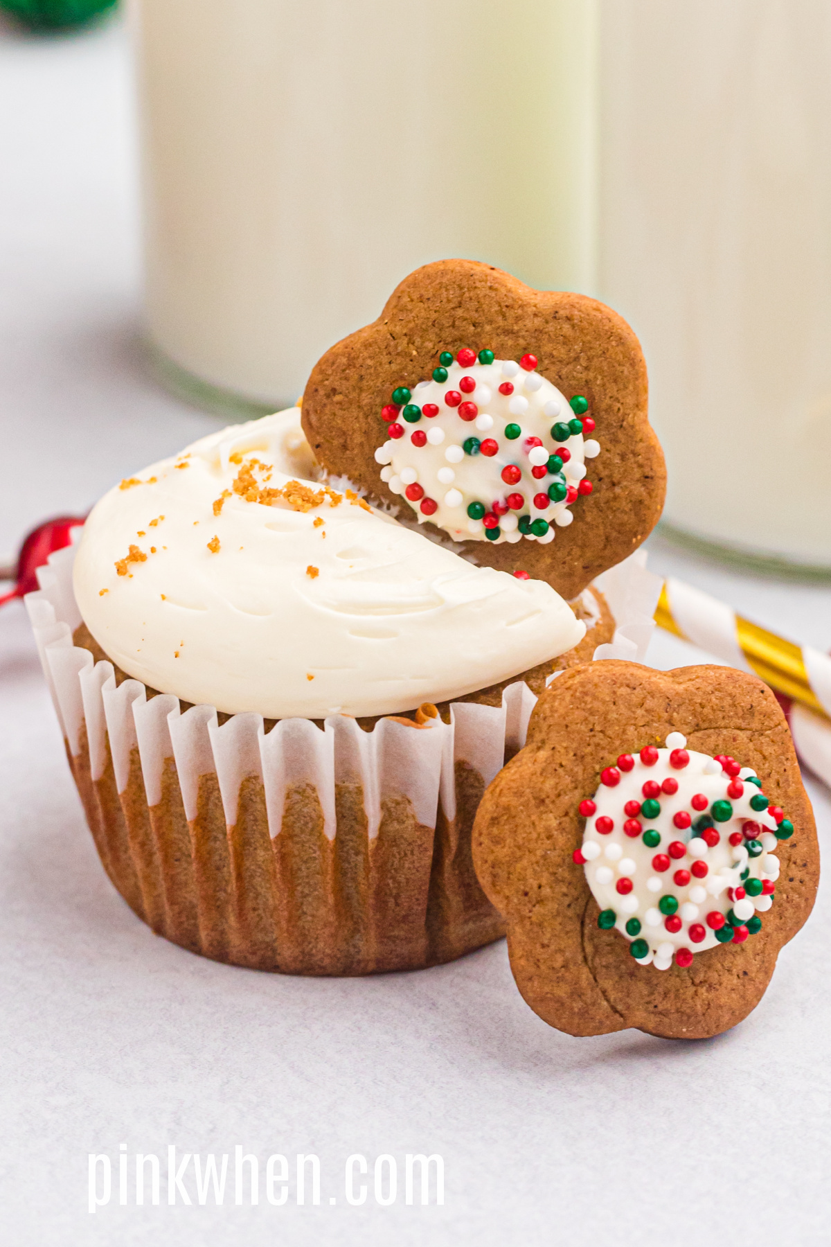 Gingerbread cupcakes with cream cheese frosting and topped with a cookie before serving.