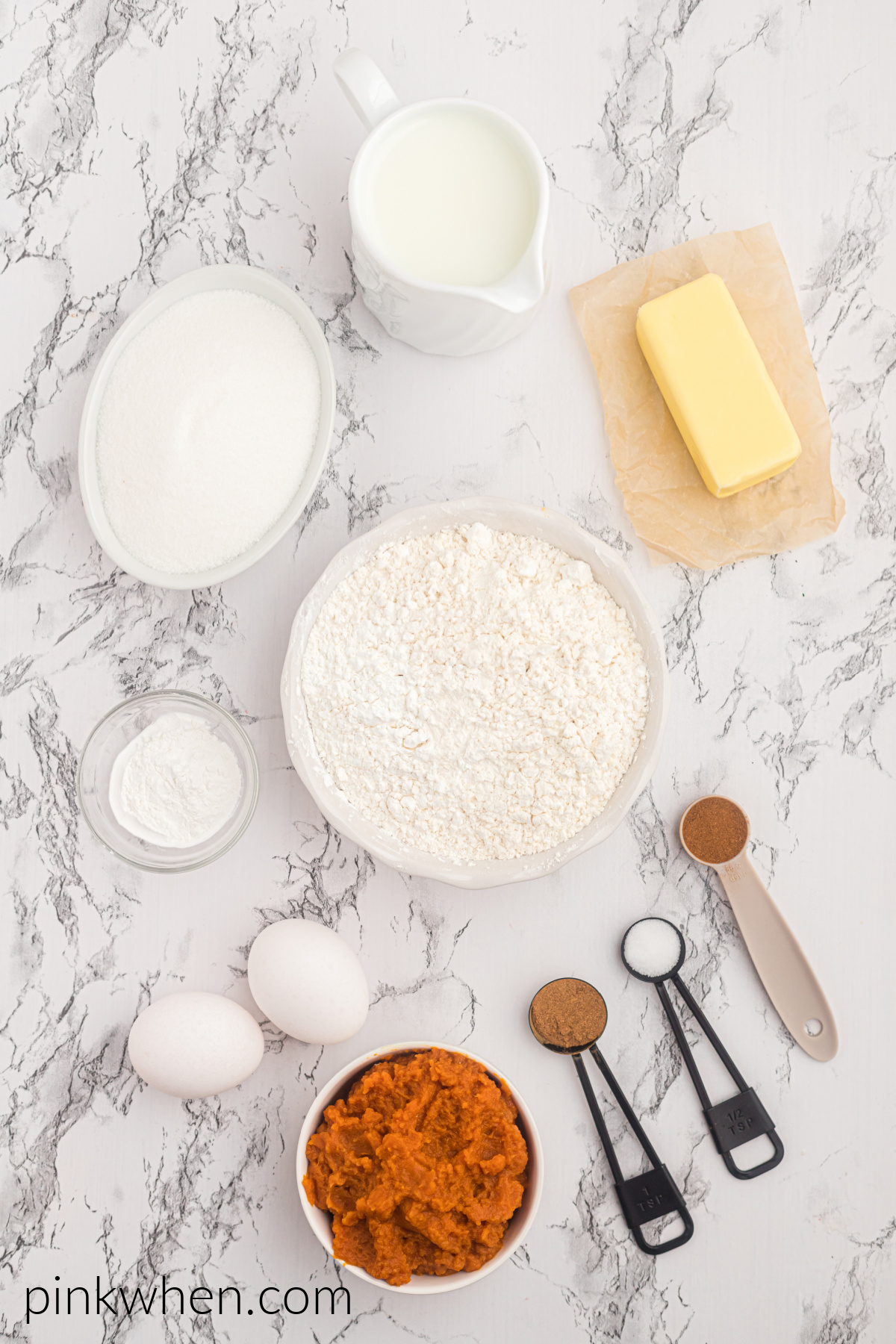 Ingredients needed to make pumpkin spice cupcakes.