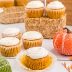 Pumpkin spice cupcakes on a board ready to eat.